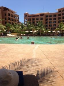 Judy lovin' pool time at Villa Del Palmar